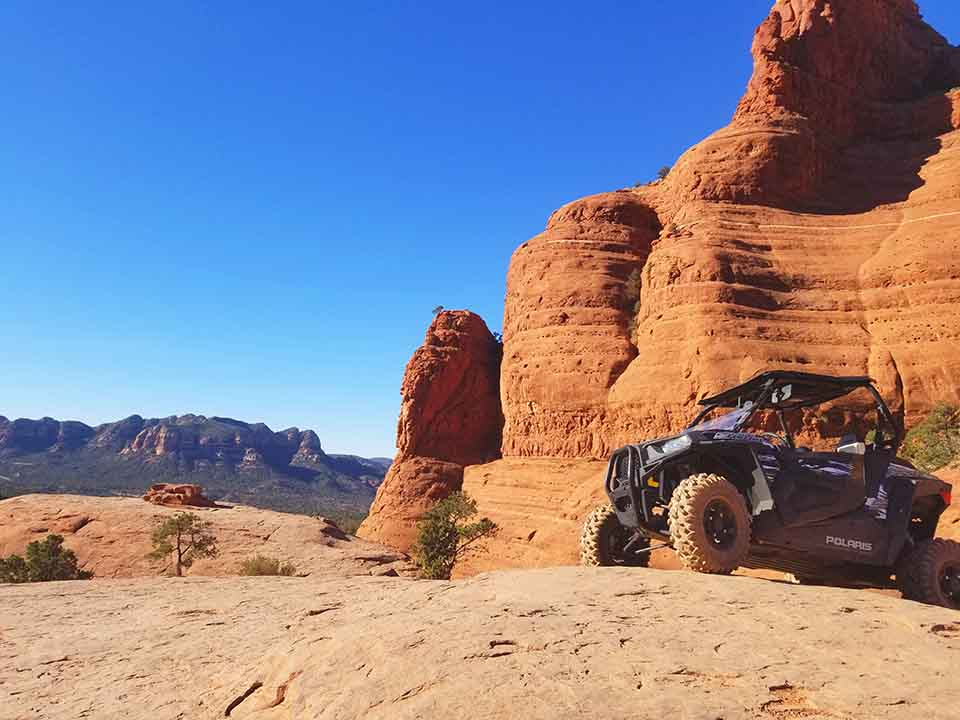 Polaris RZR with Sedona Red Rocks in the background