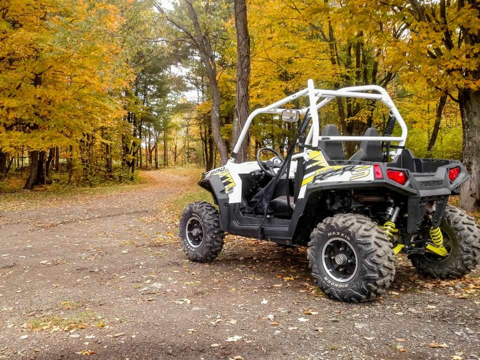 RZR in the yellow Fall leaves at Adirondack ATV Tours