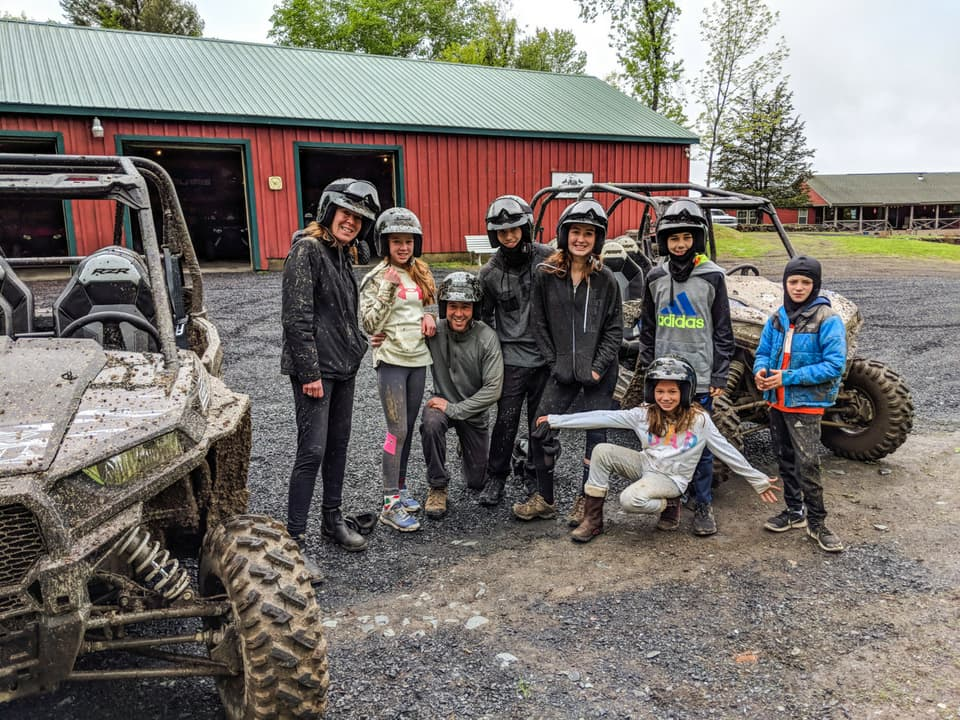 Happy customers after a ride at Adirondack ATV Tours