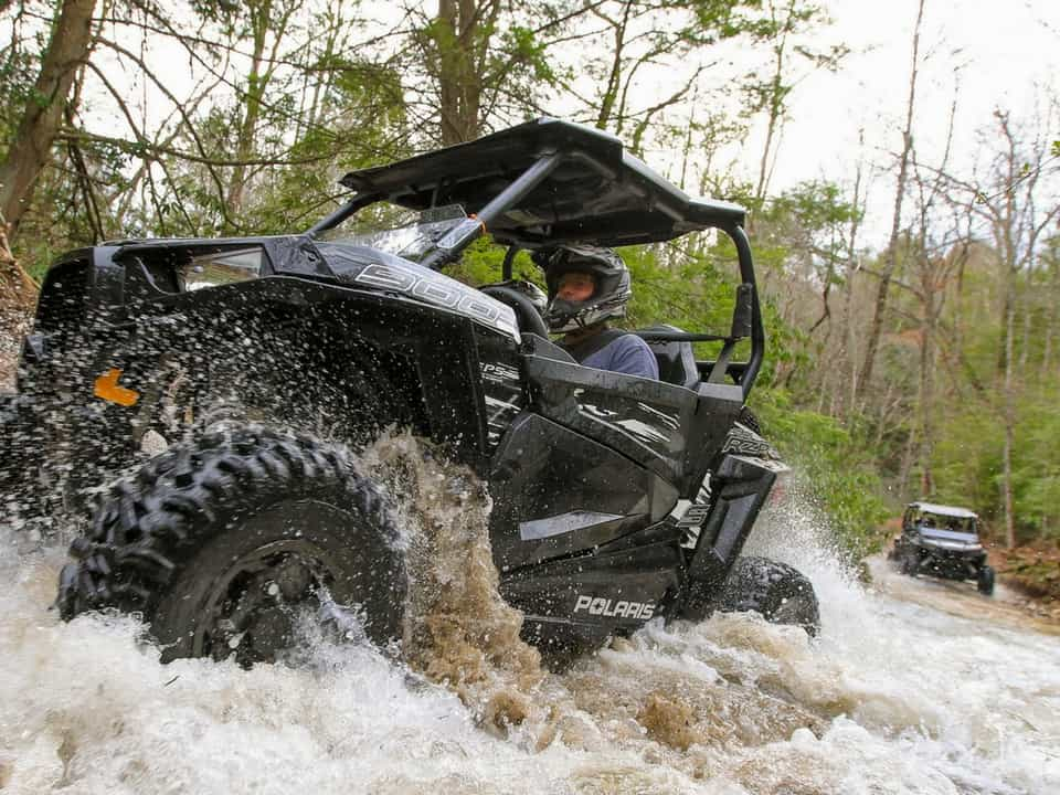A RZR driving through water on the Hatfield-McCoy Pocahontas Trail