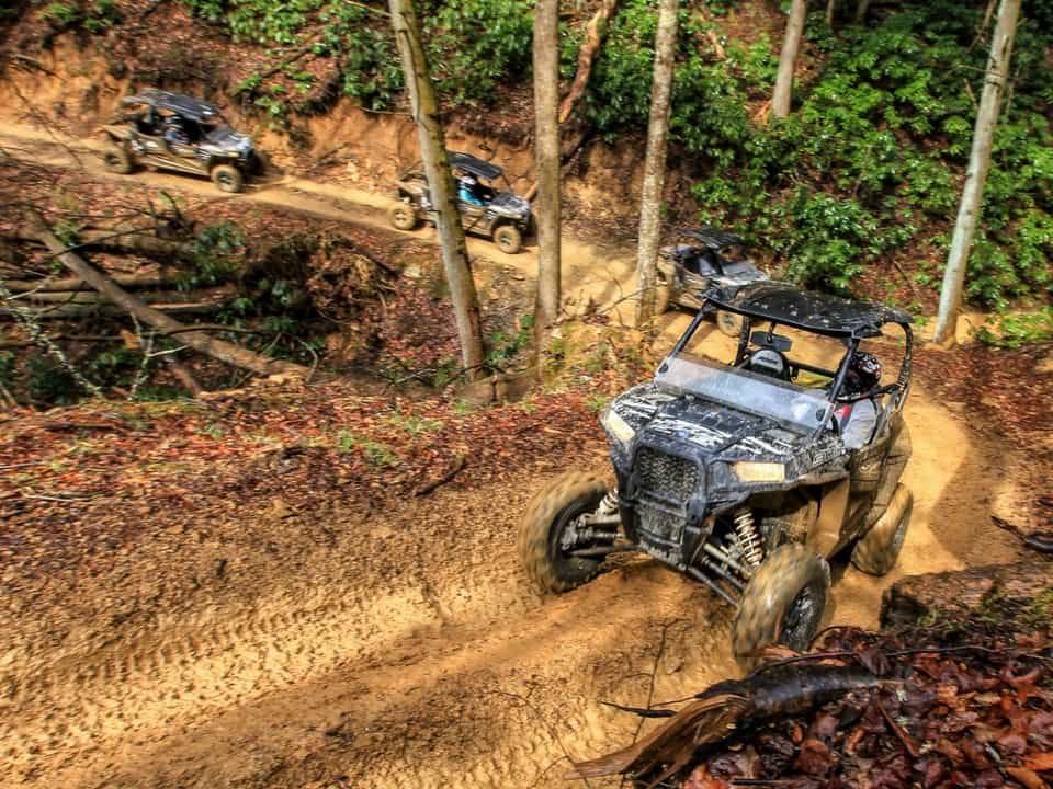 RZR's rounding a turn on the Spearhead Trail