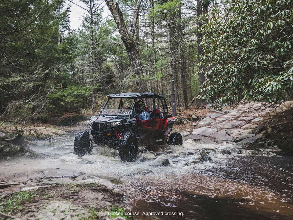RZR crossing stream on the trail at Monticello Motor Club