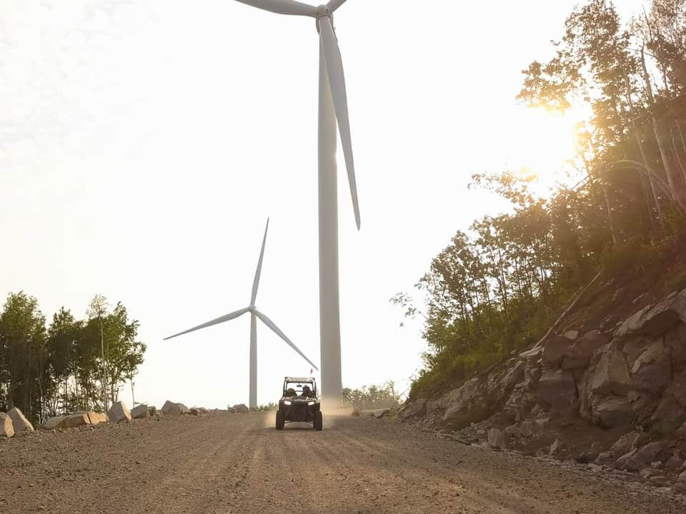 RZR with windmills in the background at Northeast