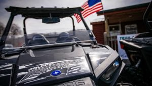Polaris RZR with an American flag in the background