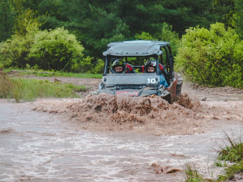 A RZR taking a dip at Monticello Motor Club