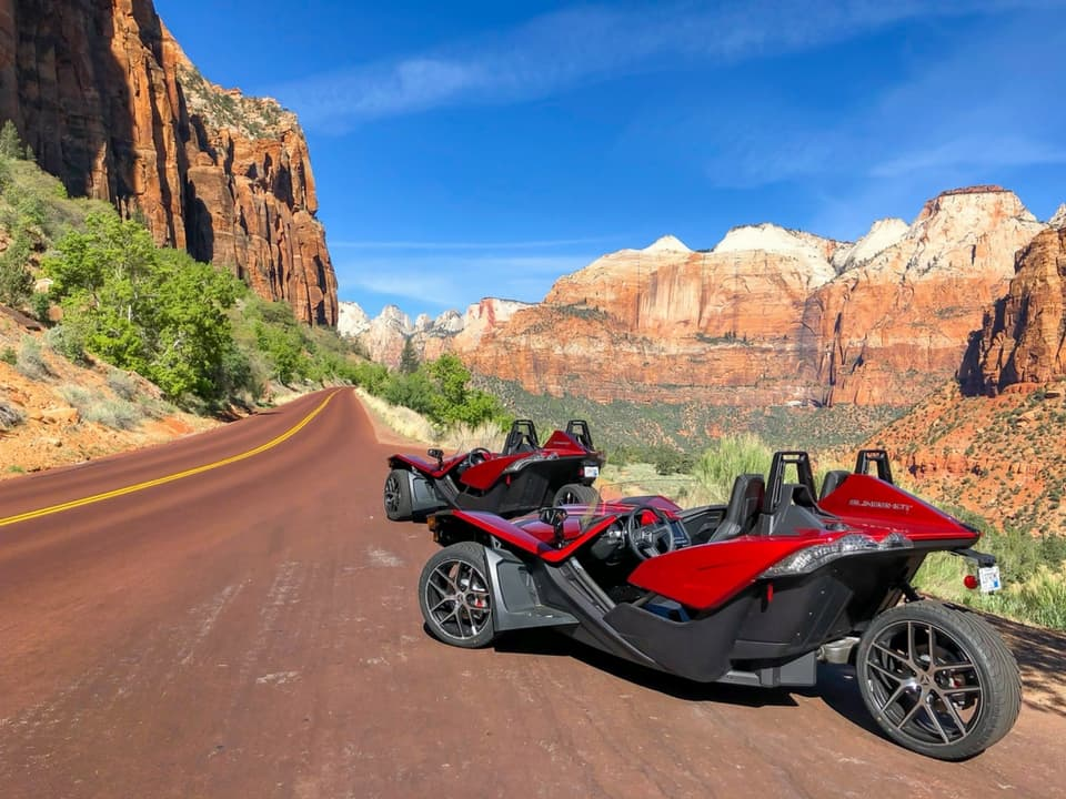 2 Slingshots lined up off the road at Zion National Park