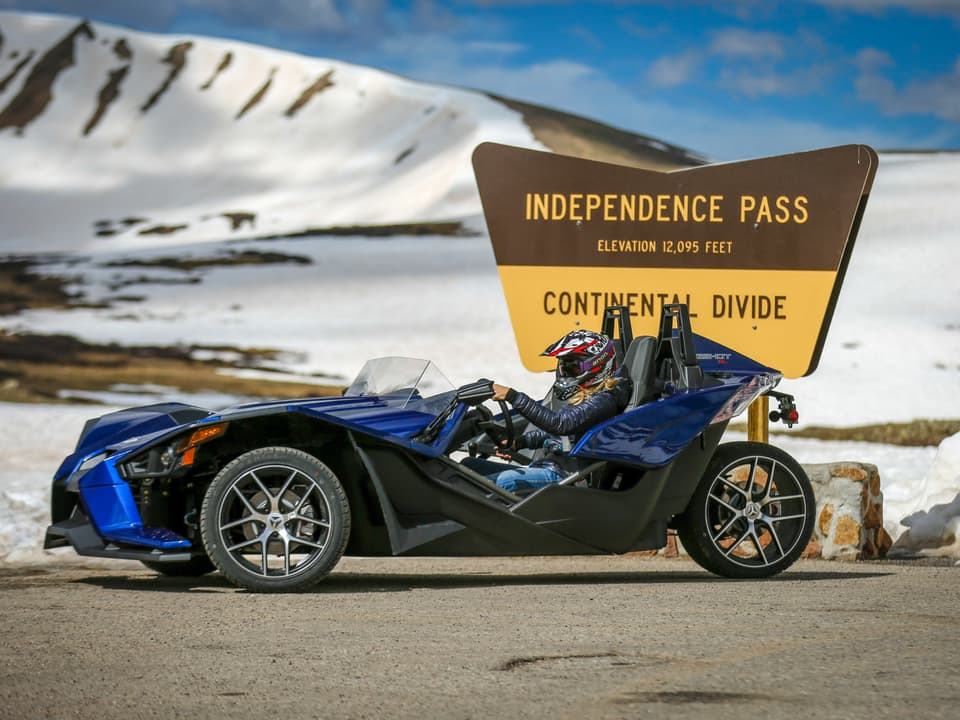 Slingshot in front of the Independence Pass sign