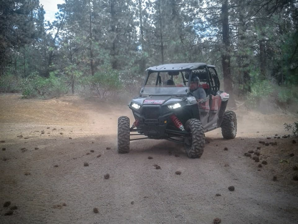 RZR rounding a corner at Outriders