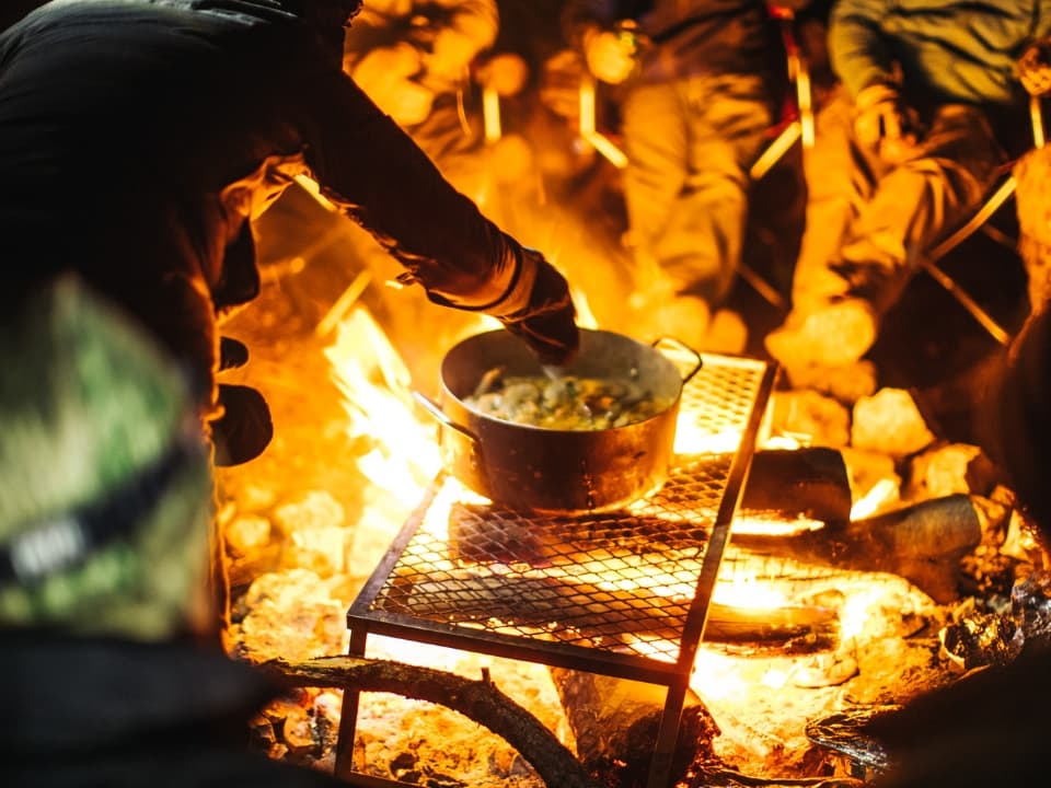 Cooking over a campfire during the 4 Day Grand Canyon Tour with Wilderness Collective