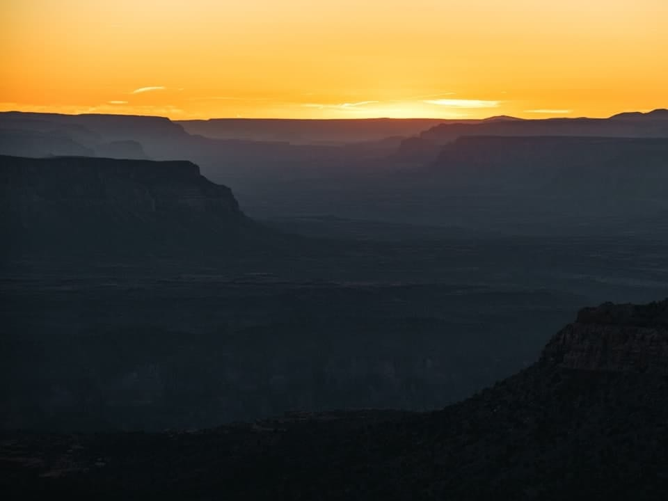 Sun setting behind the Grand Canyon