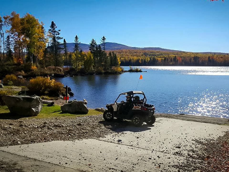 RZR in front of a lake at Northeast