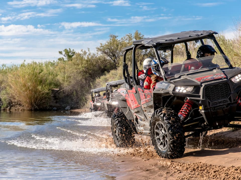 RZR's riding along the lake at Pirate Cove