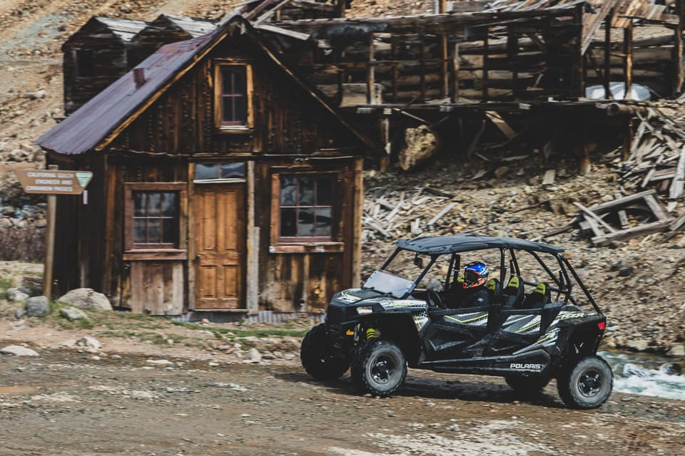 Driving past the abandoned buildings in a RZR