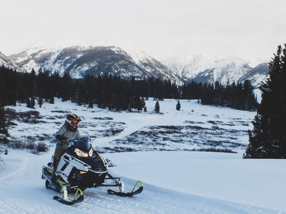 Guests on Polaris Snowmobiles in Silverton, CO
