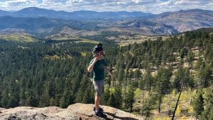 Guest standing on a cliff at North Divide Trail System in Colorado Springs
