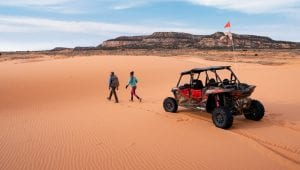 Travis Burke walking from a RZR at the Coral Pink Sand Dunes