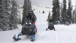 Guests on a Polaris snowmobile Adventure in Steamboat Springs, CO.