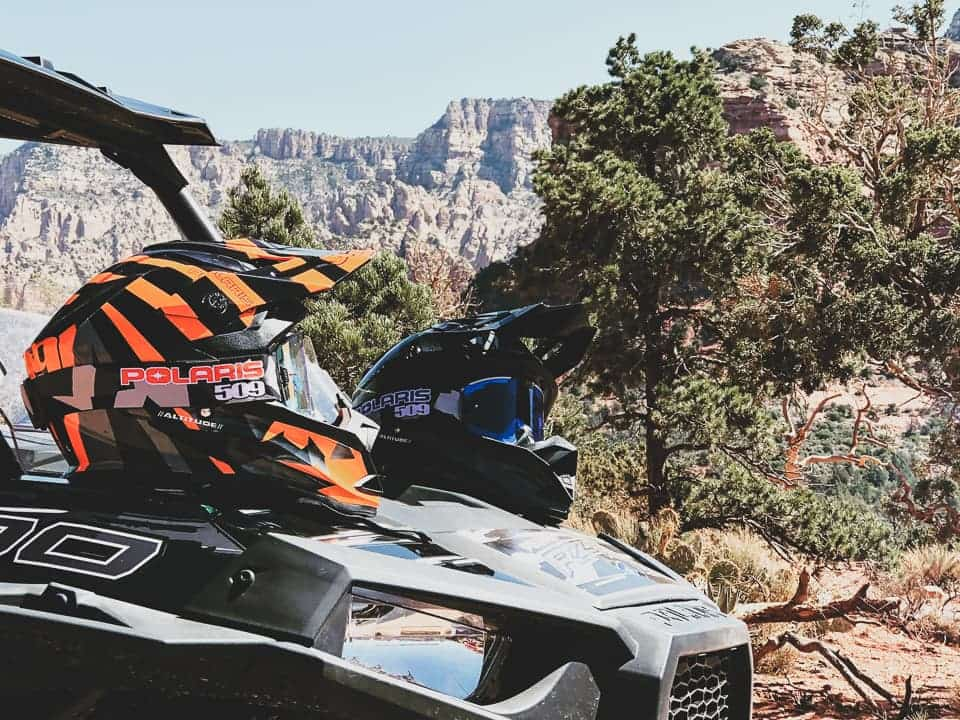 Helmets sitting on the hood of a RZR at Sedona