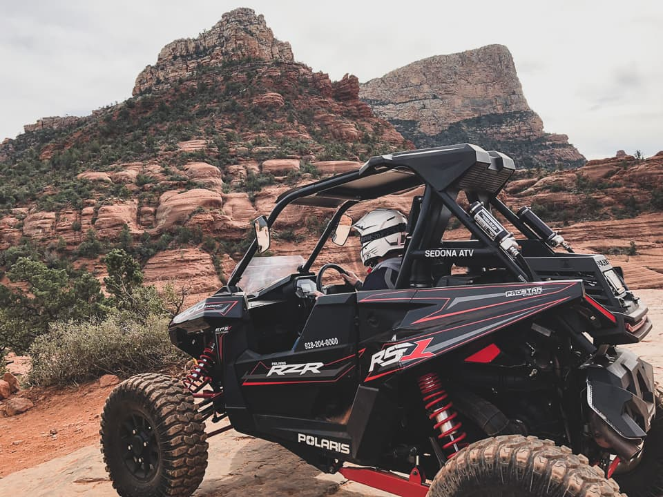Guest sitting in a RS1 at Sedona ATV