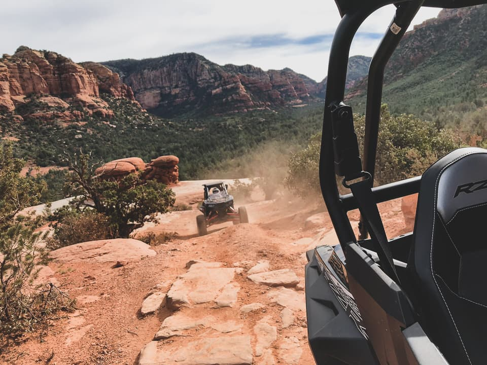 Looking back at another RZR on the trail at Sedona ATV