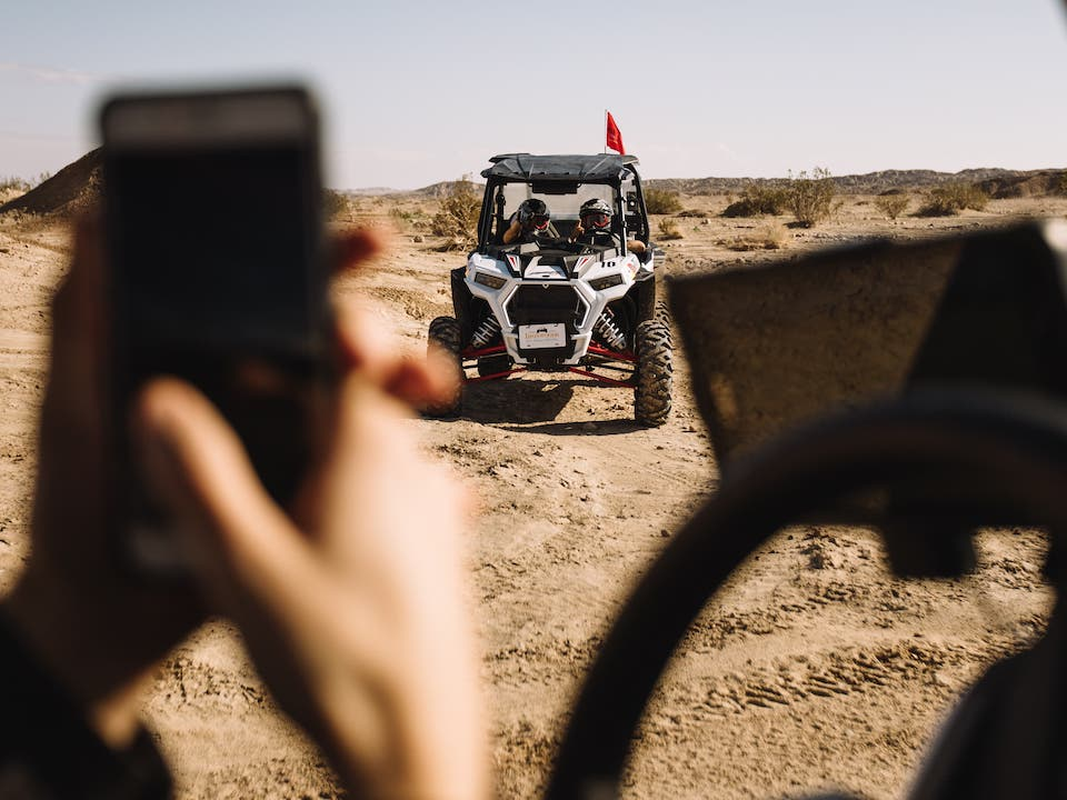 Snapping a photo of riders in a RZR at Ocotillo Wells SVRA