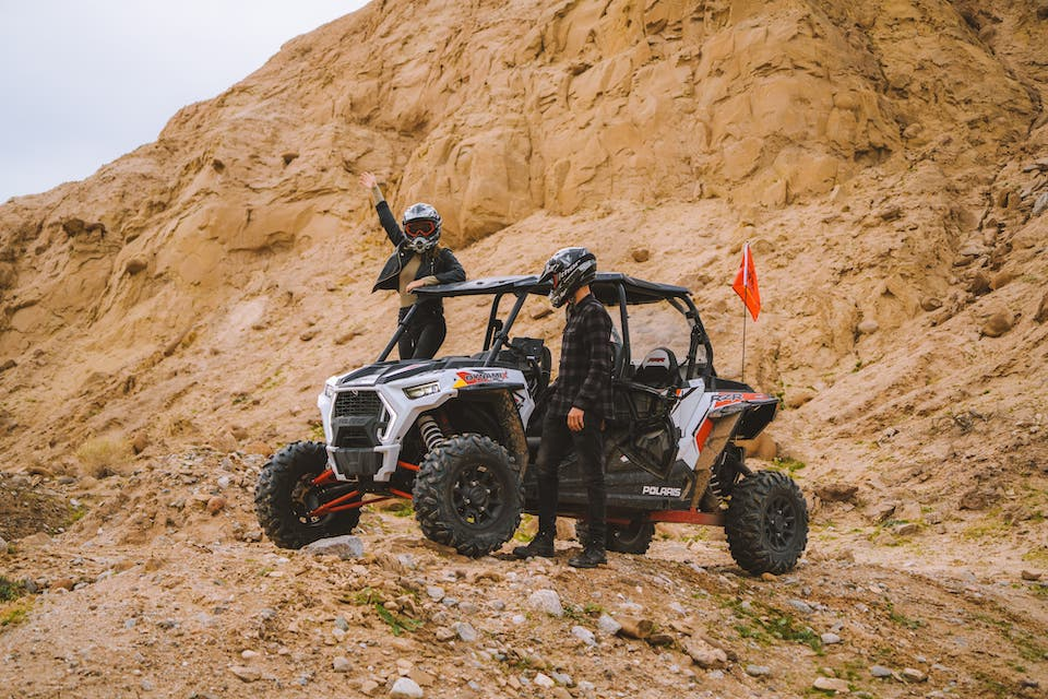 Guests posing with a RZR Turbo at Ocotillo Wells SVRA