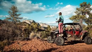 guest overlooking the desert view by a Polaris RZR