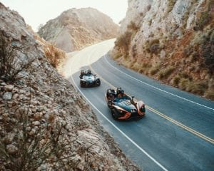 aerial view of guests driving Polaris Slingshots