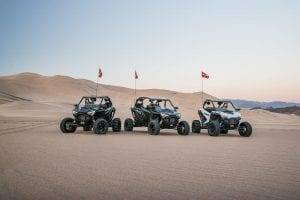 3 Polaris RZR PRO XP's lined up in the desert