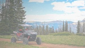 Polaris RZR parked in front of a scenic view