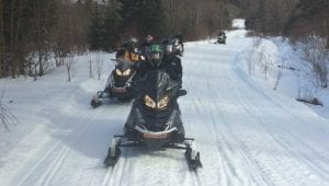 Group of Polaris snowmobiles out on an adventure