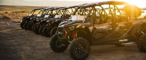 Polaris RZR's lined up in the sunset in the desert