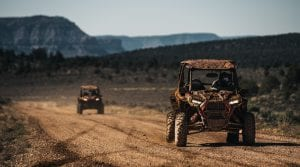 Polaris RZR's driving down a dirt path in the Grand Canyon