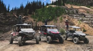 guests cheering during their ride by Polaris RZR's