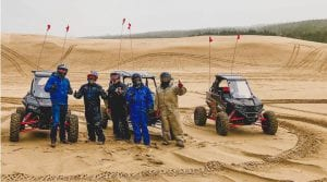 guests giving thumbs up during their adventure in the sand dunes