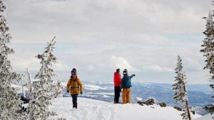 guests overlooking the snowy mountains of Colorado