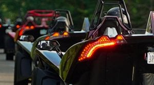 a line of Polaris Slingshots from behind