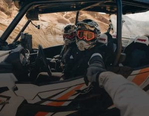 guests cheering on each other during their off-roading adventure in the desert