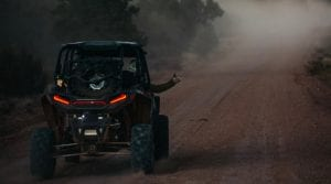 guests riding a Poalris RZR on the trail through the Grand Canyon
