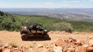 guest riding a Polaris RZR on a rocky trail in the Rocky Mountains