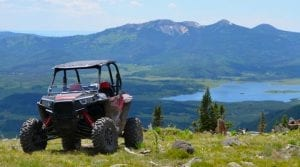 Polaris RZR parked in front of the scenic back country of the Rocky Mountains