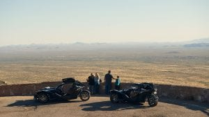family at a scenic overlook in Arizona with Polaris Slingshots