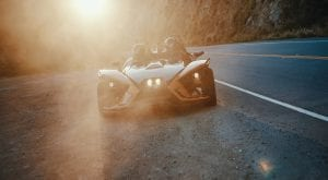 guests parked in a Polaris Slingshot during sunset