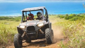 guests riding a Polaris RZR along the coast in Hawaii