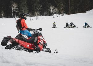 Female riders snowmobiling at Spearfish Canyon Lodge