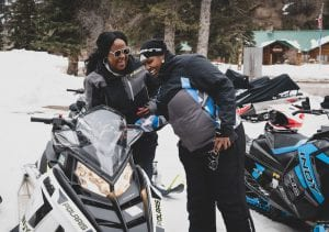 Two ladies checking out Polaris INDY snowmobile