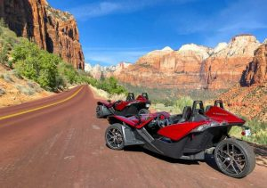 Polaris Slingshots parked along a scenic back road through Zion National Park