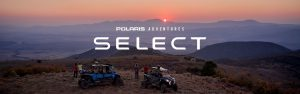 Polaris Adventures Select Logo over off-road vehicles parked at sunset